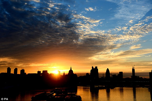 Glorious: The sun rises over St Paul's Cathedral, London at the weekend