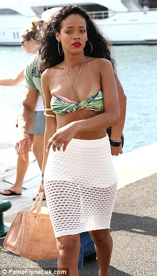 Popular choice: Rihanna (L) and Tara Reid (R) have also been holidaying in St Tropez this week