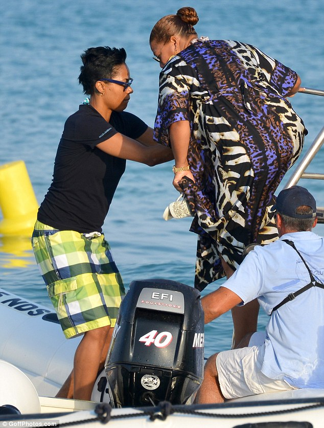 All aboard: Queen Latifah was helped on board a boat by an unknown female companion