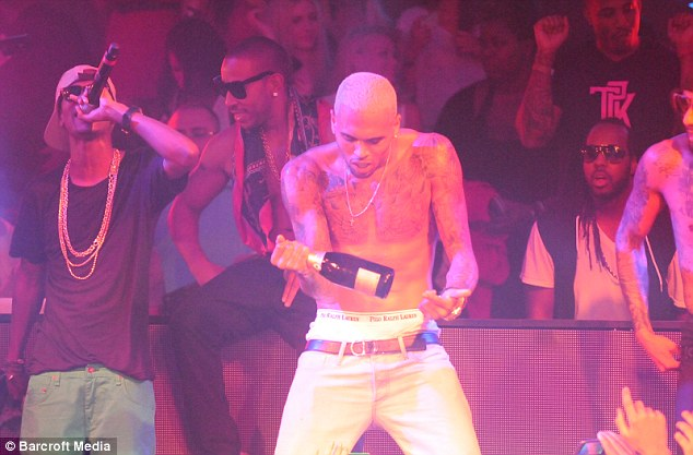 Superstar trio: Chris Brown joined forces with Swizz Beatz and Ludacris to perform at the Gotha Club in Cannes last night