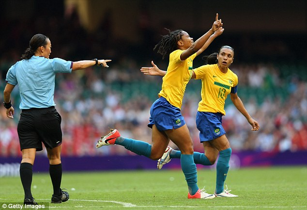 Warning shot: Brazil leap-frogged Team GB to top Group E thanks to a 5-0 drubbing of Cameroon