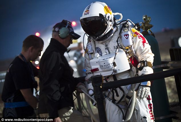 Kitted out: Mr Baumgartner wore a full-pressure suit equipped with parachutes and an oxygen supply as there is virtually no air to breathe at the height from which he leapt