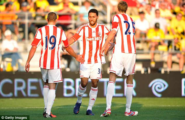 Round of applause: Peter Crouch and Ryan Shotton congratulate Walters after his goal