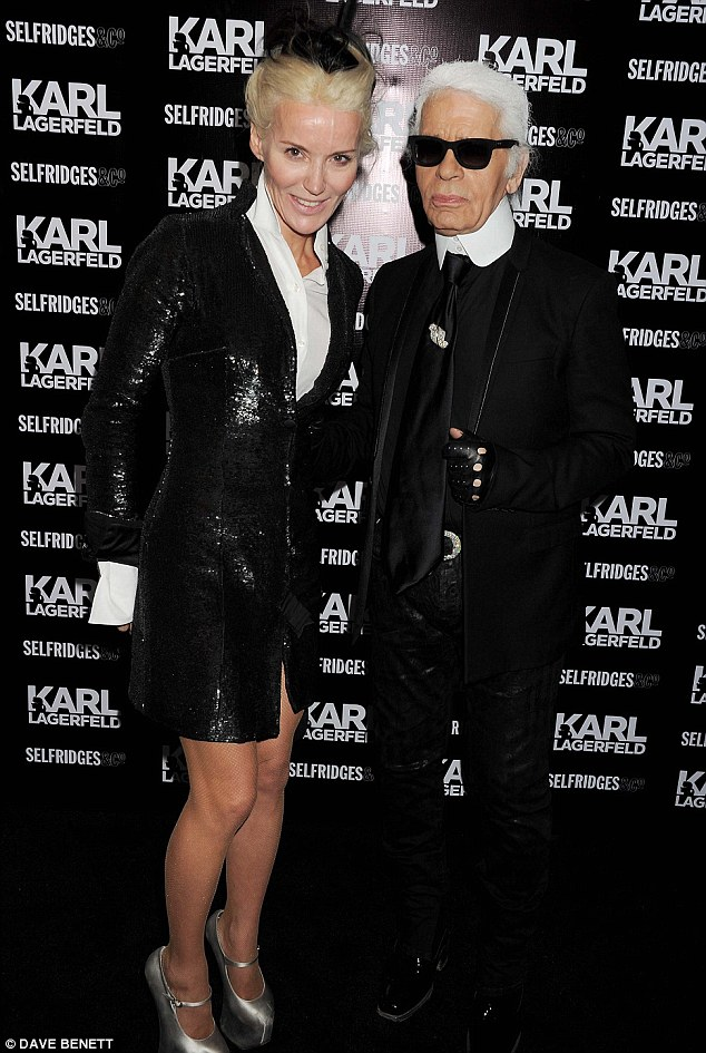 Monochrome magic: Daphne Guinness, who this year raised hundreds of thousands of pounds for charity with the sale of items from her fashion archive, with Karl Lagerfeld