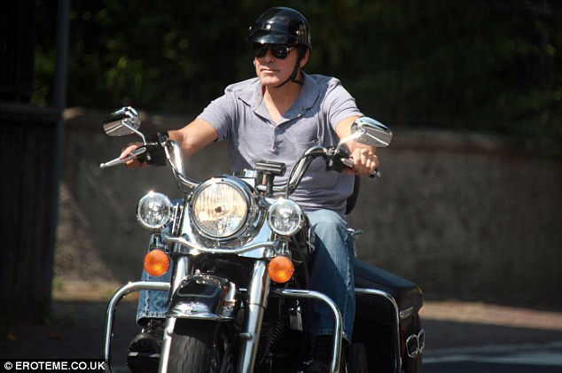 Cruising Clooney - The Hollywood star takes in the sights of Lake Como during a bike ride with pals