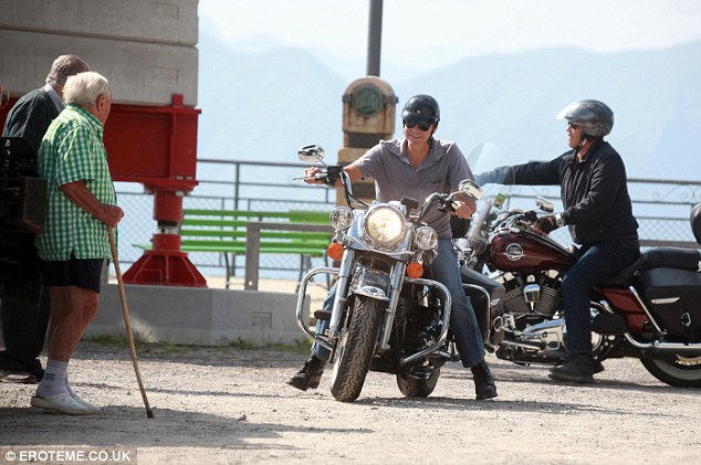 Too close for comfort: Clooney just misses two pensioners after a quick pitstop to take in the beautiful sights