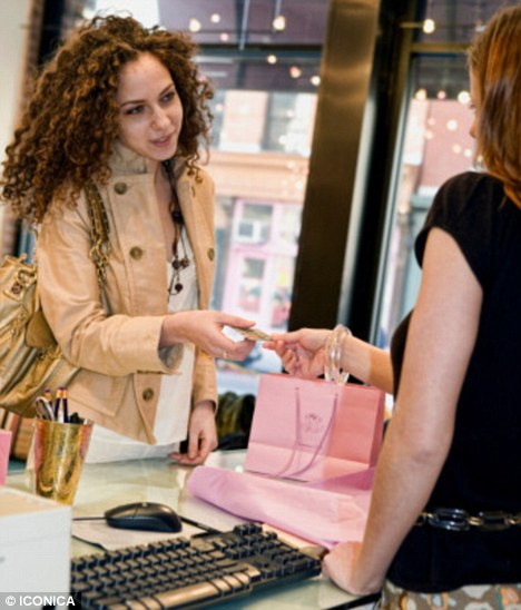 Big spender: Women are most likely to use a secret credit card to buy clothes and shoes (posed by models)