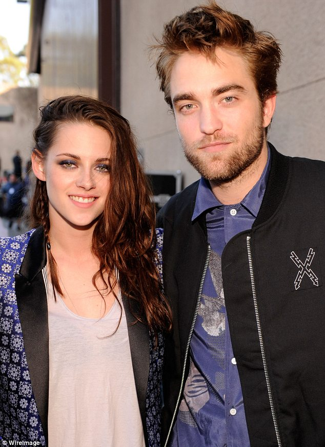 What a difference two days makes: Kristen and Rob looked happy when they appeared together at the Teen Choice Awards on Sunday
