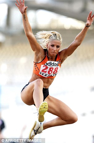 Greece's  Voula Papachristou competes in the women's triple jump in Athens on July 30, 2011