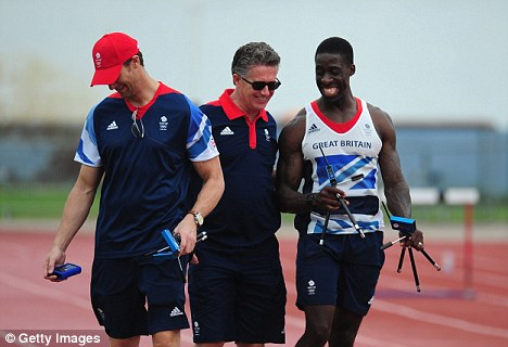 Sanctions: UK Athletics head coach Charles van Commenee, pictured with Dwayne Chambers (right), has said he will not exclude Idowu from the Games