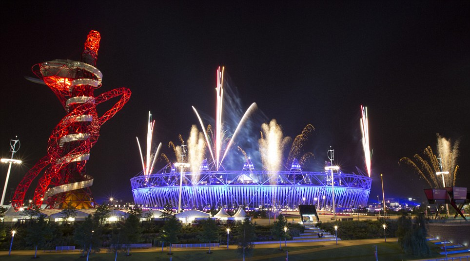 Lights fantastic: A dazzling firework show illuminates the Olympic stadium and Anish Kapoor's sculpture Orbit , during rehearsals in Stratford, East London