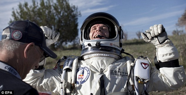 Sky-high ambition: Baumgartner of Austria celebrates after he lands in the New Mexico desert