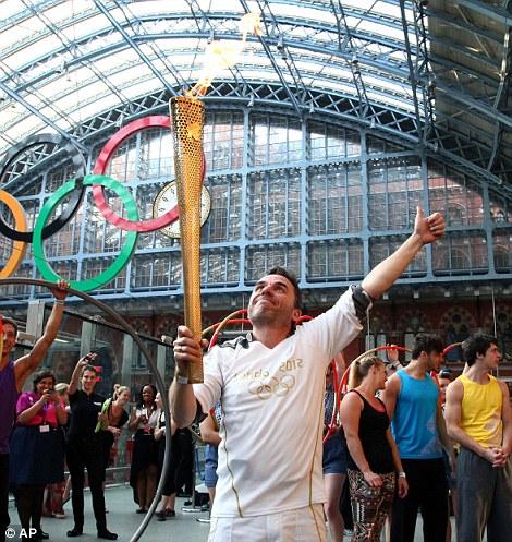 Let it shine: Daniel McCubbin carried the torch inside London St Pancras station