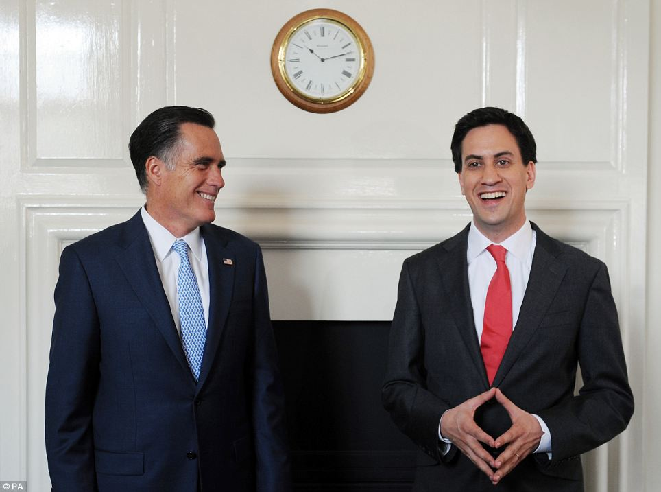 Labour leader Ed Miliband greets U.S. Presidential candidate Mitt Romney