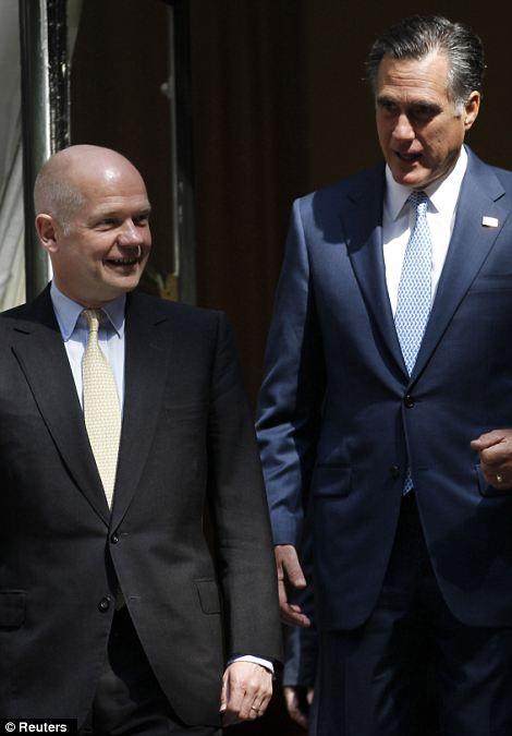U.S. Republican Presidential candidate Mitt Romney (R) tours the Great Pavilion exhibit with British Foreign Secretary William Hague