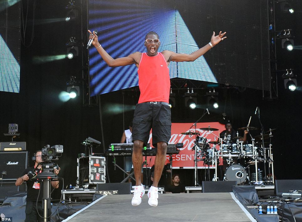 High jump: Wretch 32 performing at the Coca Cola London 2012 Olympic Torch Relay concert in Hyde Park, central London