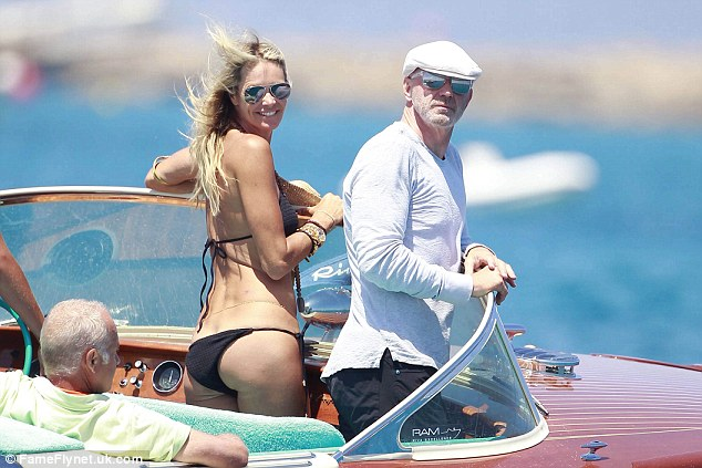Probe: The FSa are also investigating  Roger Jenkins, pictured above with his supermodel girlfriend Elle Macpherson in Ibiza in June