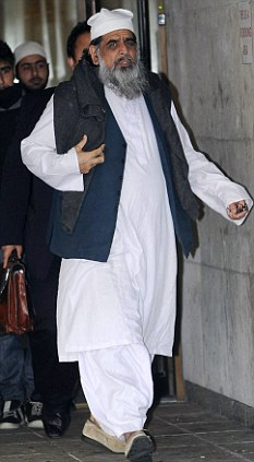 Free to go: Abid Hussain leaving Manchester Crown Court where the Muslim preacher who tried to strangle his 16-year old daughter avoided jail