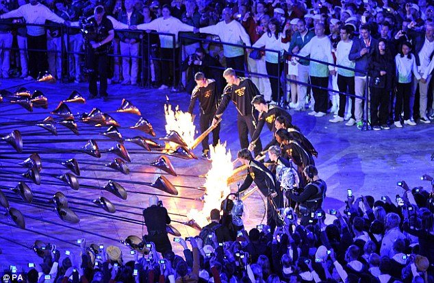 Surprise: In an unexpected move a group of seven young athletes lit the Olympic Cauldron during the London Olympic Games 2012 Opening Ceremony