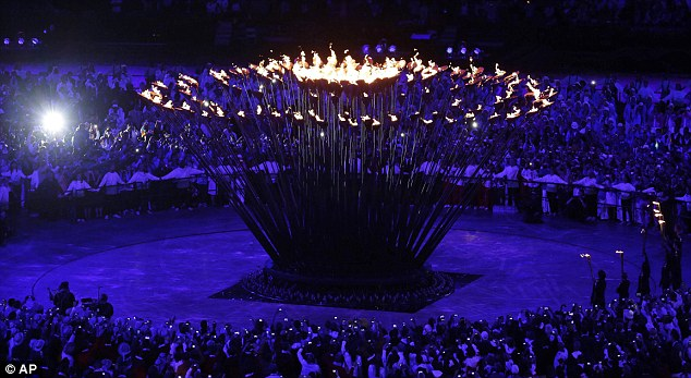 Lighting up the games: Having lit the copper petals the cauldron came together in spectacular fashion