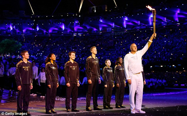 Handover: Sir Steve Redgrave was given the honour of carrying the torch into the stadium where he then handed it over to the up and coming athletes