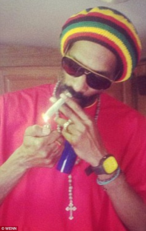 No shame: Earlier this year Snoop announced he wanted to speak to Barack Obama in a smoky room so he could ask him to legalise his favourite drug