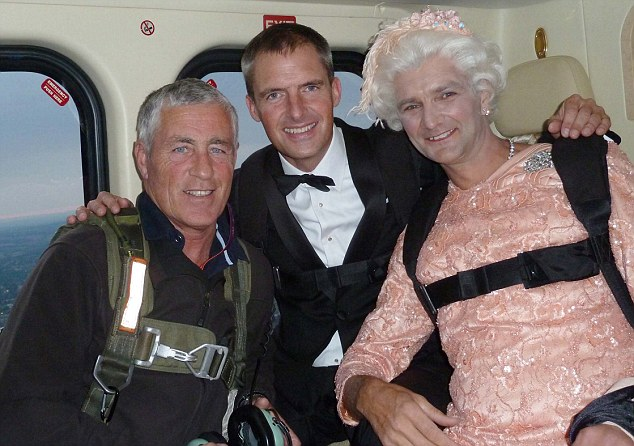 Gary Connery, right, the skydiving 'Queen' prepares for his dramatic arrival at the Olympics opening ceremony on Friday night pictured with James Bond double Mark Sutton, middle, in the helicopter en route to the stadium