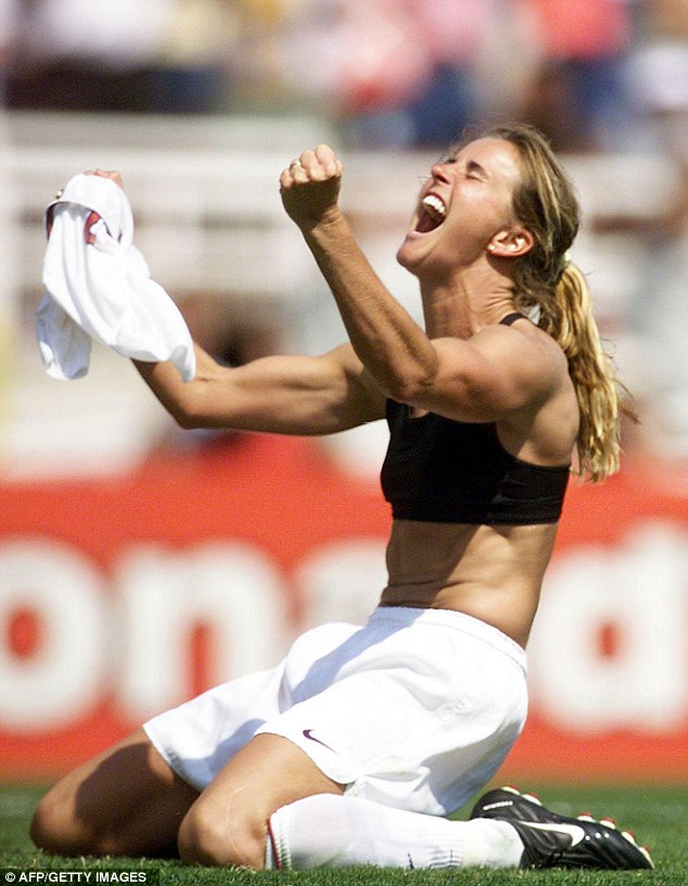 Brandi Chastain of the US celebrates after kicking the winning penalty shot to win the 1999 Women's World Cup final against China 10 July 1999 at the Rose Bowl in Pasadena