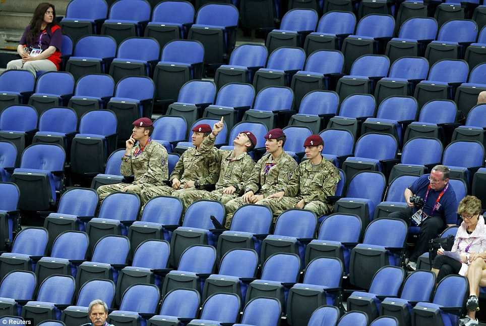 Pointing out the gaps: Soldiers fill empty IOC seats for the women's gymnastics yesterday