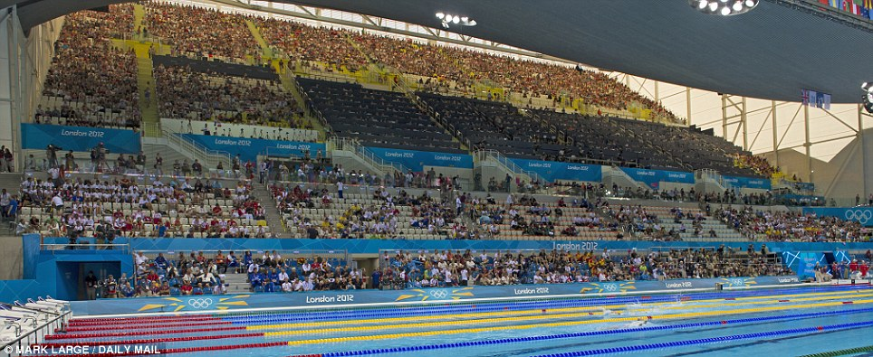 Plenty of room: The scene at the Aquatics Centre on Saturday, on the first day of events