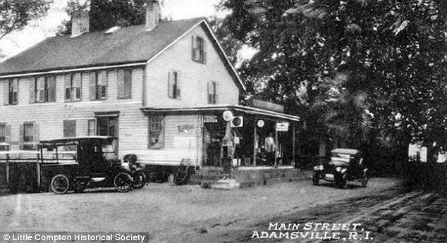 Passing hands and time: The store's front porch is seen offering cover to a few men outside while two automobiles rest front