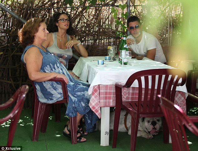 Eating for two: Rafaella looked relaxed as she sat down for a meal with her family