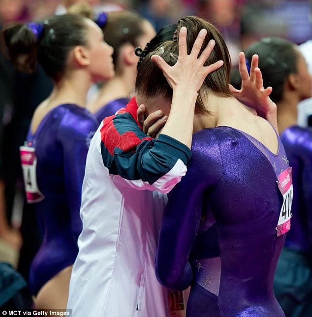 Heartbreak: Jordyn Wieber wept while consoled by USA assistant coach Jenny Liang after the final team and individual standings were displayed in London on Sunday