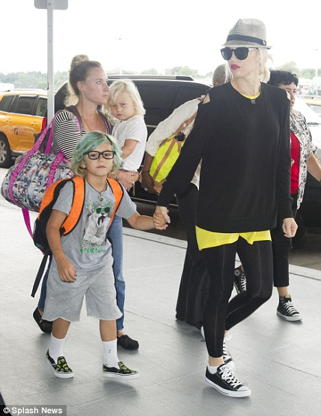 Buzz worthy ensemble: The singer stood out in her black and yellow attire