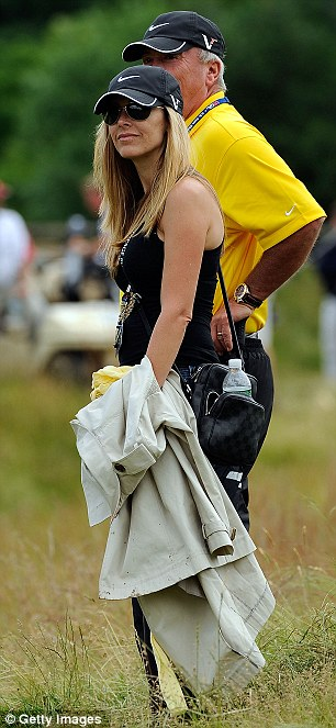 Susie Duval with her husband's coach Puggy Blackmon watch Duval during the final round of the 109th U.S Open in 2009