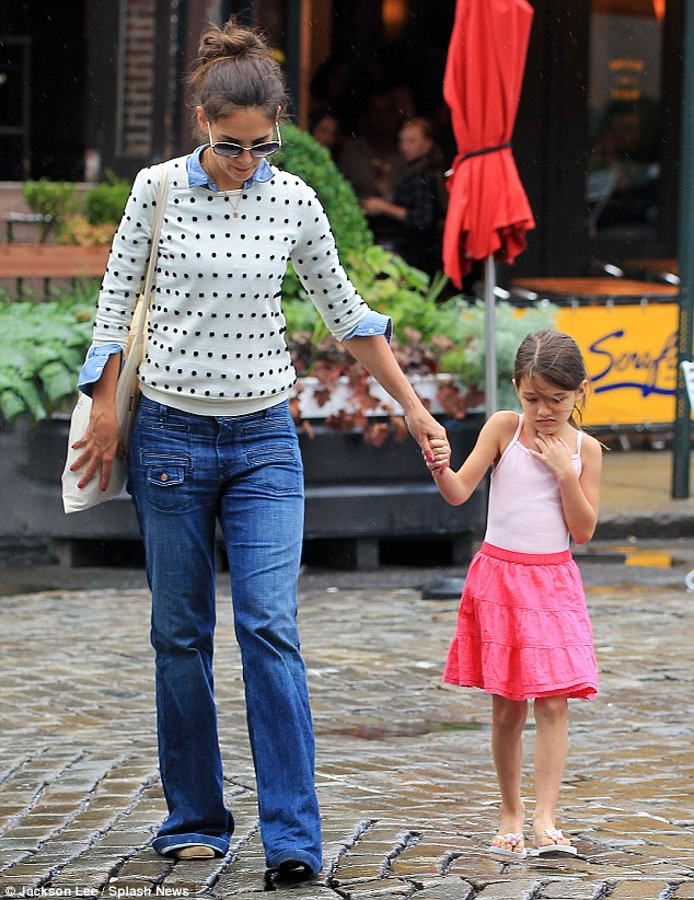 Scary puddle! Suri looked wary and unsure of crossing the fresh puddles in her tiny flip-flops