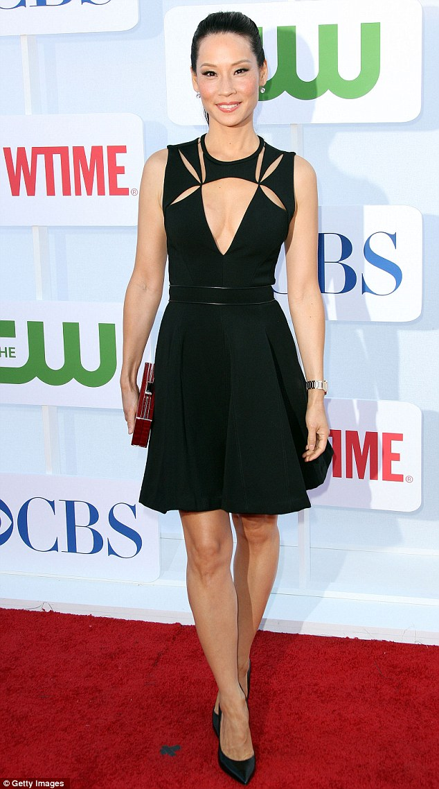 Breathtaking: Lucy Liu wore a daring cutaway gown at the CW, CBS and Showtime 2012 Summer TCA party