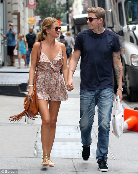 Take a break: Green is on holiday in New York with his girlfriend Made In Chelsea star Millie Mackintosh