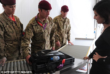 British soldiers check a woman's bag as she enters a London 2012 venue. None of the people pictured were involved in the incident at Lord's Cricket Ground