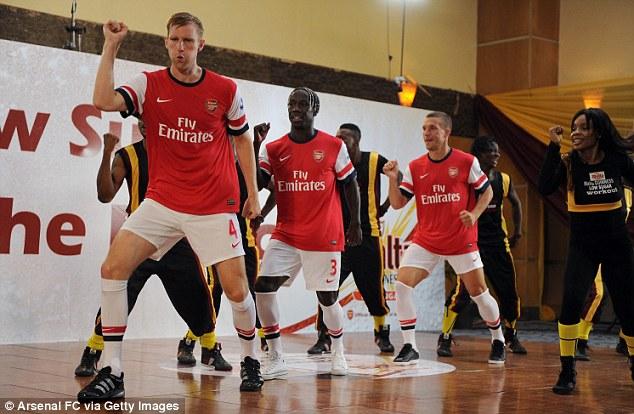 Best foot forward: Bacary Sagna, Per Mertesacker and Lukas Podolski have shown off their skills