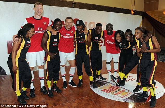 Making a point: Arsenal sent the first-team stars to Nigeria on a relationship-building trip