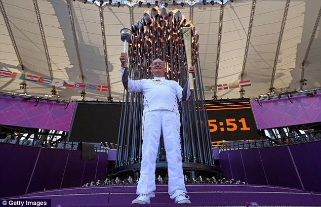 Honour: The flame was lit by Austin Playfoot, one of the torchbearers at the 1948 Games