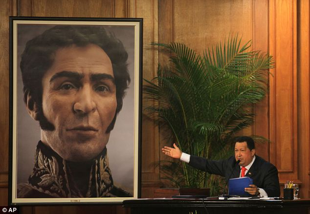 National hero: Venezuela's President Hugo Chavez unveils a photograph-like portrait of Venezuela's independence hero Simon Bolivar on the 229th anniversary of Bolivar's birth