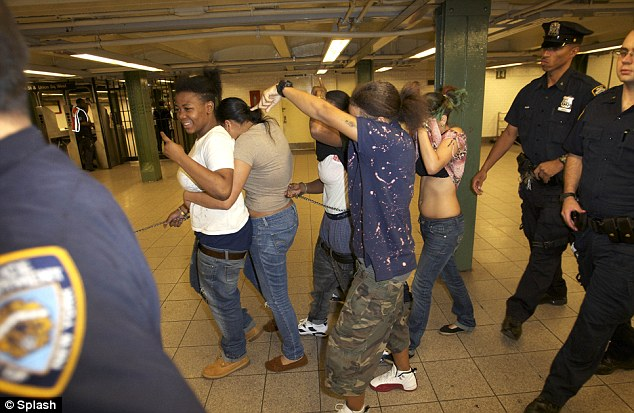 Gang members: The women were arrested at the 23rd Street station and as they were being led out they made obscene gestures and swore at photographers