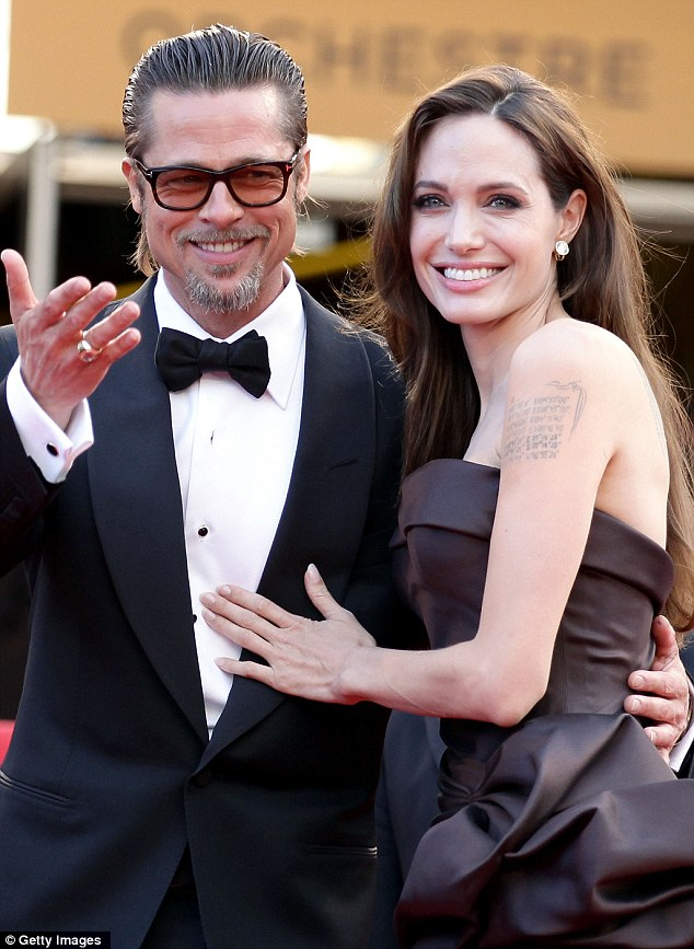 Fake accident: The false report, which went viral online over the weekend, stated that the actor, seen here with partner Angelina Jolie, had had crashed into a tree and died while snowboarding in Zermatt, Switzerland