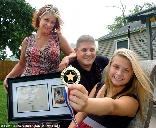 Proud family: 12-year-old Miranda Bowman's quick-thinking saved her life when her grandfather died suddenly at the wheel of their speeding car forcing her to jump in the driver's seat and steer to safety