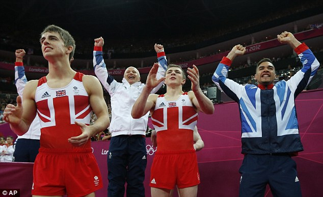 Historic moment: Britain's men celebrate winning the bronze medal in the team event