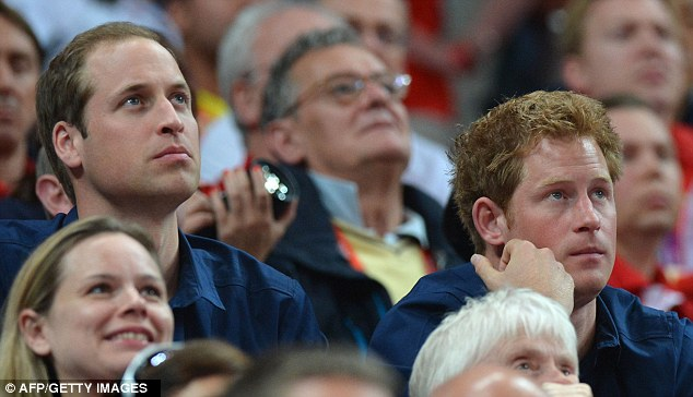 By Royal command: Princes William (left)  Harry watch the men's team final of the artistic gymnastics event