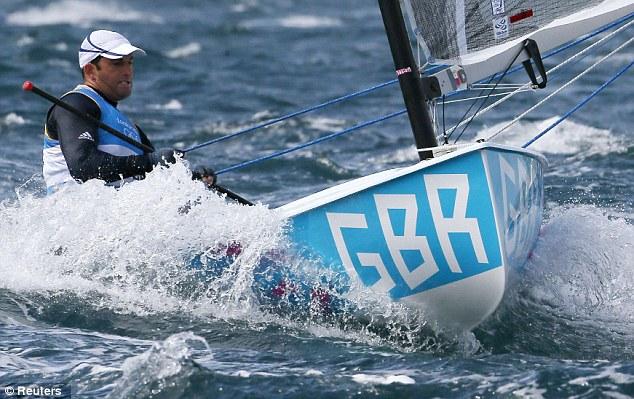 Struggle: Ben Ainslie sails in the third race of the Finn class