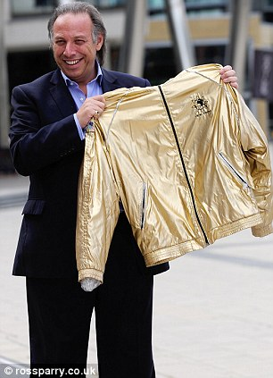 Winning gold: Stuart Levin bought a Jimmy Savile tracksuit for £550